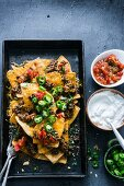 Chili nachos with cheese and jalapenos
