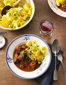 Oven cooked goulash with parsley noodles