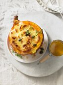 Pumpkin gratin in a hollowed out pumpkin