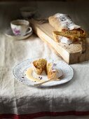 Apple strudel with icing sugar and vanilla sauce