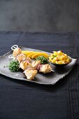 Chicken skewers with mango salsa and mango slices