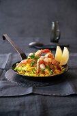 Paella in an iron pan