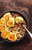 Potato dumplings on creamy mushroom ragout