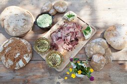 Bread and cheese on rustic wooden table