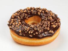 A doughnut with chocolate glazing