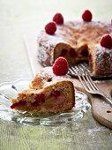 Rhubarb and hazelnut cake with raspberries, sliced
