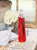 A bottle of homemade strawberry syrup