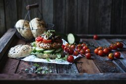 A vegan burger with a panko-crusted patty and fried wild mushrooms
