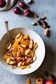 Peach, nectarine and plum wedges in a bowl