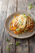 Vegetable spaghetti with grilled halloumi
