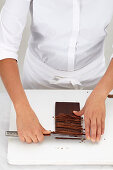 Chef chops chocolade with a knife