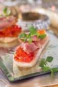 Canapes with tuna and tomato jelly