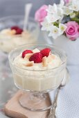 Pineapple and coconut cream with raspberries
