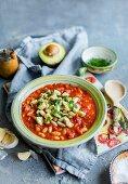 White bean and tomato stew with avocado and parsley pesto