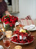 A table laid with crayfish and glasses of wine (Sweden)