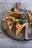 Stinging nettle and vegetable frittata on a wooden board