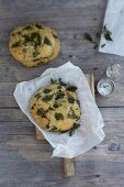 A stinging nettle bread roll on greaseproof paper