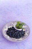 Wild blueberries and wild herbs on a plate