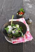 Stuffed comfrey rolls with wild herbs and tomatoes