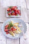 Finger-shaped potato dumplings with strawberry and woodruff salad