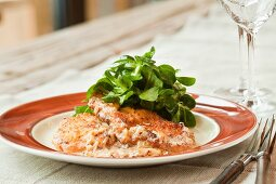 Escalope with a creamy onion sauce with lamb's lettuce