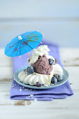 Meringues with blueberry ice cream and a cocktail umbrella