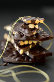 Pieces of chocolate with almonds stacked on top of each other