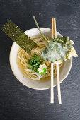 Ramen noodle soup with nori and wasabi leaf tempura