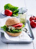 Salmon and zucchini burgers with green hummus
