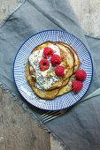 Gluten-free banana pancakes with raspberries and chia seeds