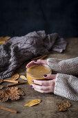 Cup of a warm pumpkin spice latte