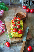 Chicken meatloaf with cherry tomatoes