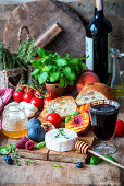 Cheese, fruit, tomatoes, bread, honey and red wine