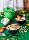 Sour cream soup with vegetables and spiced bacon butter