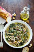 Spelt soup with mushrooms and spinach