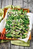 Green vegetable salad with basil dressing