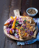 Pork chops with an orange glaze and warm vegetable salad