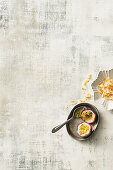 Passion fruit and coconut shavings