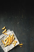 French fries on a sheet of newspaper