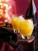 Two cocktails with brandy and oranges