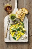 Green eggs with avocado and pistachio pesto