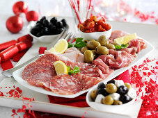 A festive sausage platter with olives for Christmas