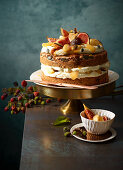 Pumpkin seed and orange cake with glazed apples, figs and cream cheese frosting