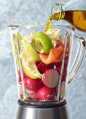 Ingredients for an apple and wild salmon spread in a blender