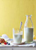 Fresh buttermilk in a glass and a bottle
