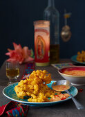 Corn fritters with spicy cheese sauce (Mexico)