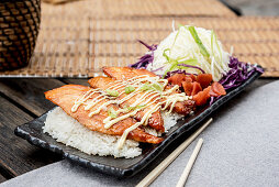 Grilled Salmon Teriyaki served with plain rice, pickles and salad (Japan)