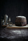 A vegan chocolate Bundt cake with icing sugar