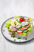 Bread with ham, egg, tomatoes and cream cheese