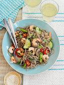 Soba noodle salad with shrimps, cucumber and sesame